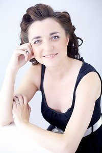 Liz Hendry black dress smile