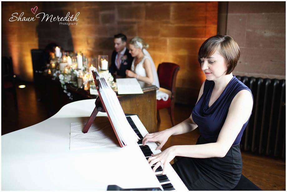 Liz Hendry performing during a ceremony at Peckforton Castle